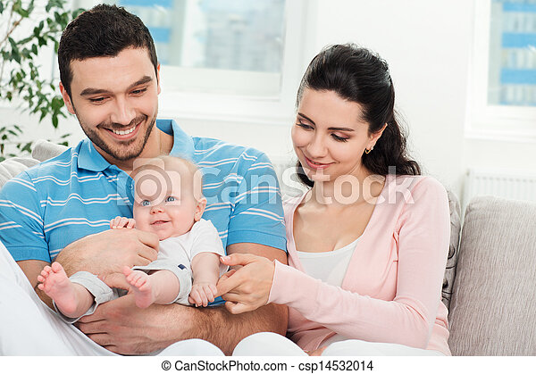 Happy young family with baby - csp14532014