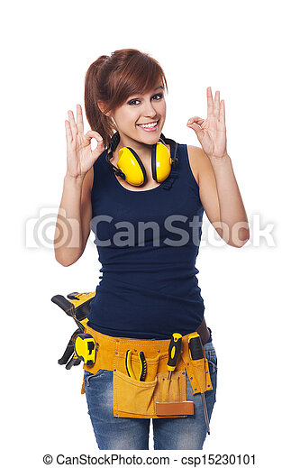 Happy young female construction worker gesturing OK sign - csp15230101