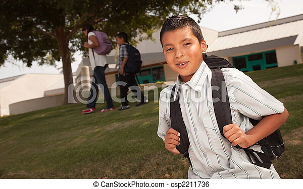 Happy Young Hispanic Boy Ready for School - csp2211736