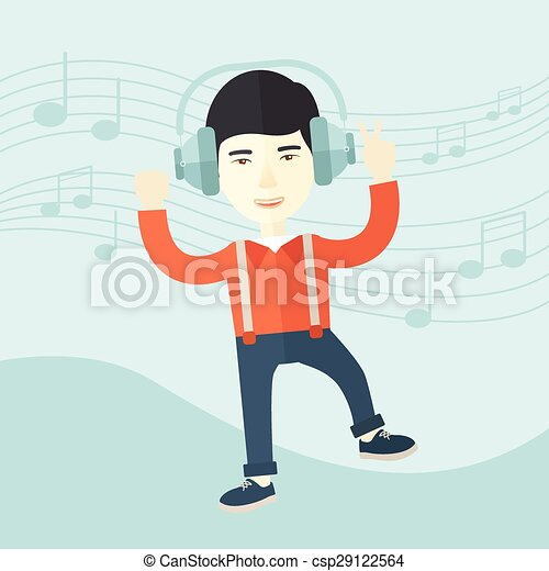 Happy young man dancing while listening to music. - csp29122564