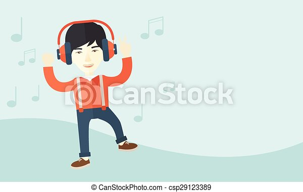 Happy young man dancing while listening to music. - csp29123389