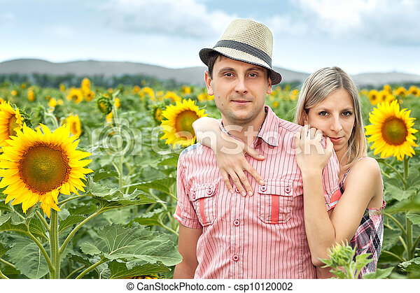 happy young pair in sunflowers - csp10120002