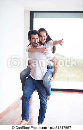 happy young romantic couple have fun and  relax at home - csp31317557