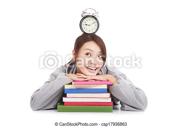 happy young student looking clock with books  - csp17936863