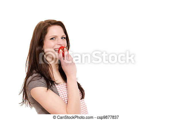 happy young woman about to eat a tomato on white background - csp9877837
