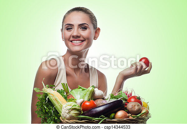 Happy young woman holding basket with vegetable. Concept vegetarian dieting - healthy food - csp14344533