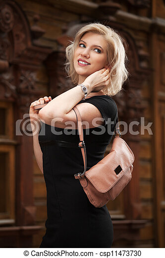 Happy young woman in black dress - csp11473730