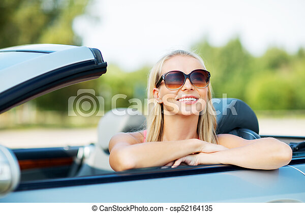 happy young woman in convertible car - csp52164135
