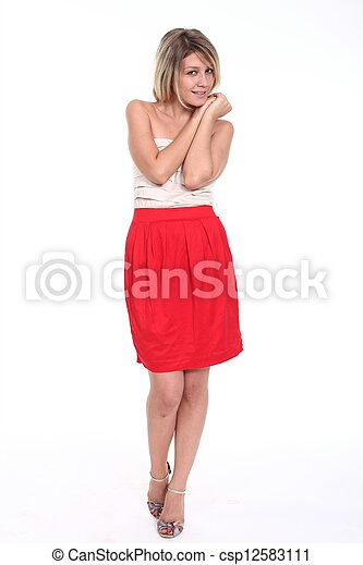 Happy young woman in dress. - csp12583111