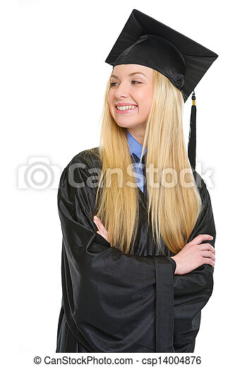 Happy young woman in graduation gown looking on copy space - csp14004876