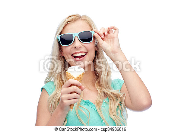 happy young woman in sunglasses eating ice cream - csp34986816