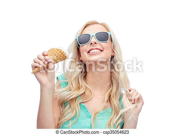 happy young woman in sunglasses eating ice cream - csp35054623