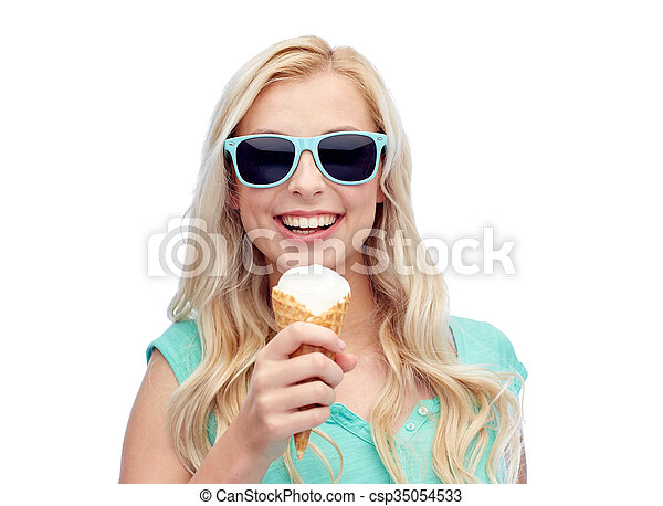 happy young woman in sunglasses eating ice cream - csp35054533