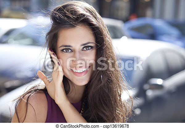 Happy young woman. Outdoor portrait - csp13619678