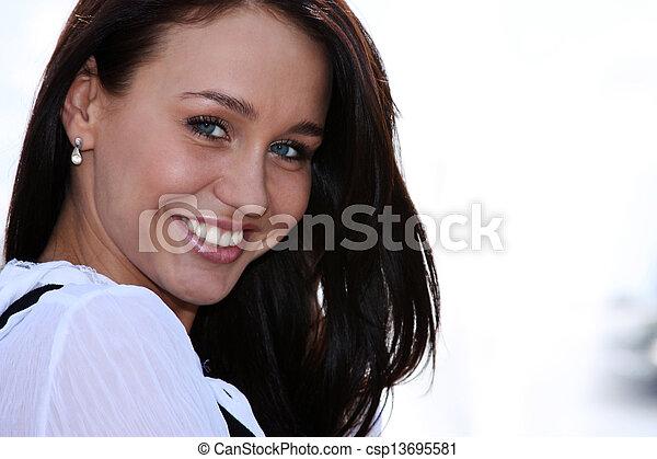 Happy young woman. Outdoor portrait - csp13695581