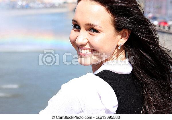 Happy young woman. Outdoor portrait - csp13695588