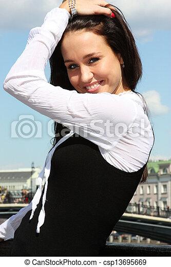 Happy young woman. Outdoor portrait - csp13695669