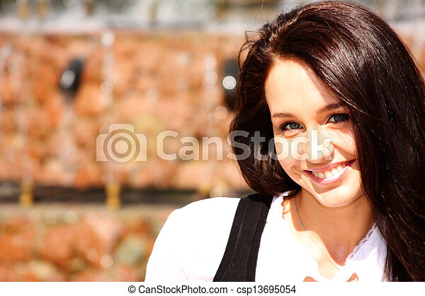 Happy young woman. Outdoor portrait - csp13695054