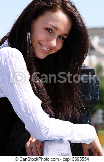 Happy young woman. Outdoor portrait - csp13695554
