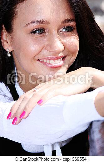 Happy young woman. Outdoor portrait - csp13695541