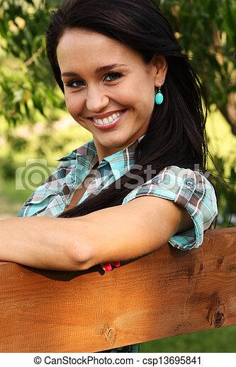 Happy young woman. Outdoor portrait - csp13695841