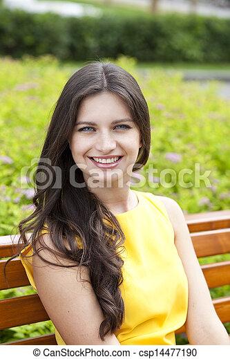 Happy young woman. Outdoor portrait - csp14477190