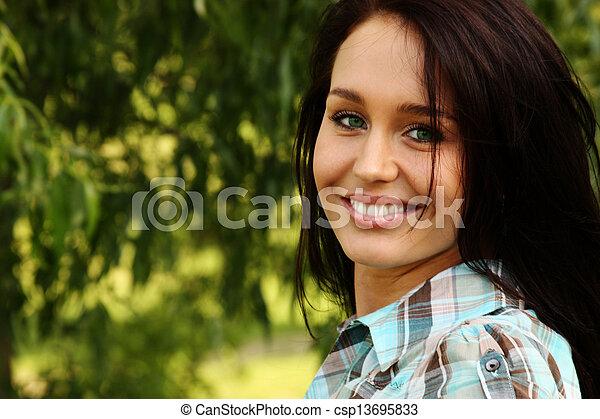 Happy young woman. Outdoor portrait - csp13695833