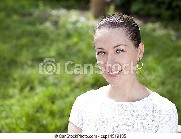 Happy young woman. Outdoor portrait - csp14519135