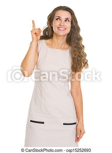 Happy young woman pointing up on copy space - csp15252693