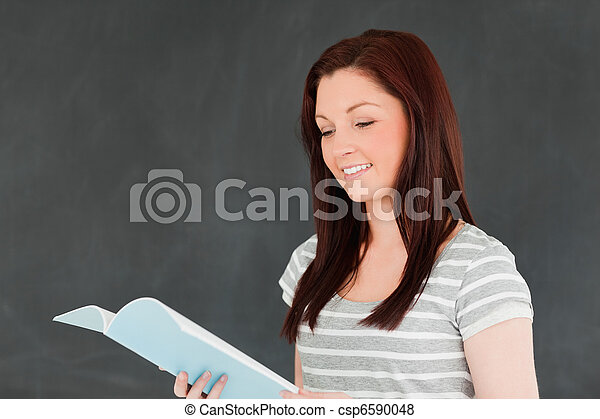Happy young woman reading her notes - csp6590048