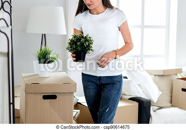 happy young woman standing in her new apartment - csp90614675