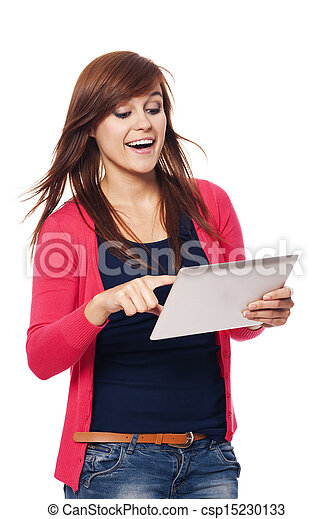 Happy young woman using digital tablet - csp15230133