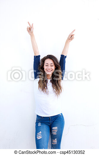 happy young woman with arms raised up - csp45130352