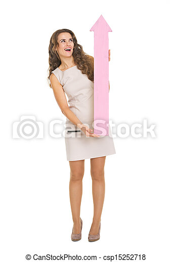 Happy young woman with arrow pointing on copy space - csp15252718
