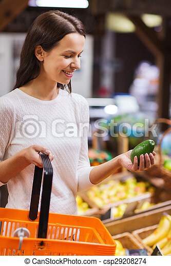 happy young woman with food basket in market - csp29208274
