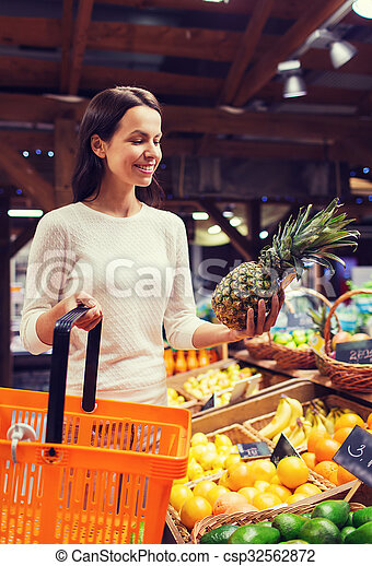 happy young woman with food basket in market - csp32562872
