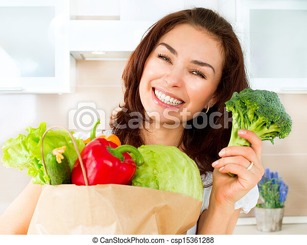 Happy Young Woman with vegetables in shopping bag. Diet Concept - csp15361288