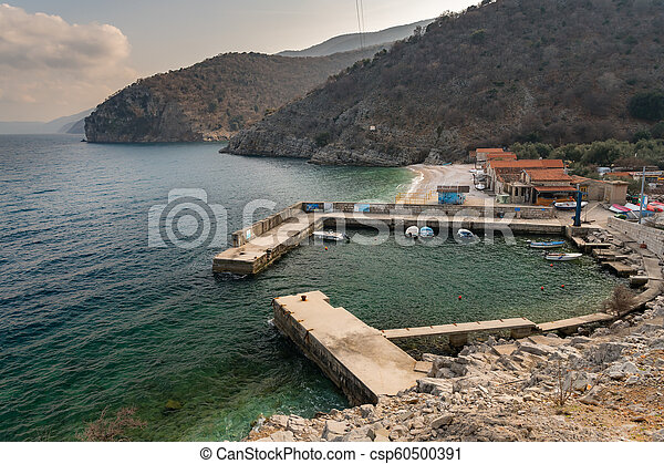 Harbor of Beli on a cloudy day in spring - csp60500391