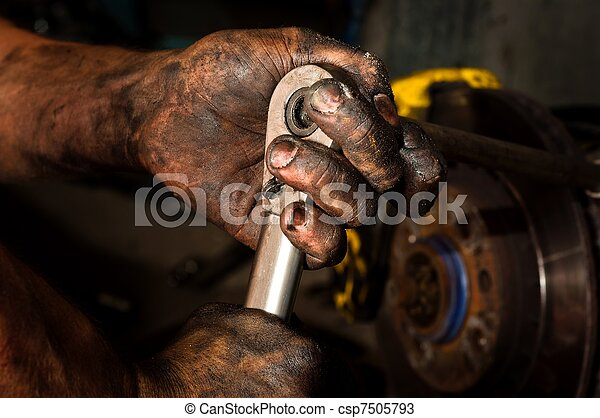 Hard working man with hands full of oil - csp7505793