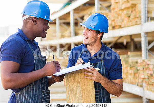 hardware store workers working in timber yard - csp20497112