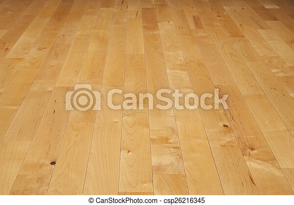 Hardwood basketball court floor viewed from a low angle - csp26216345