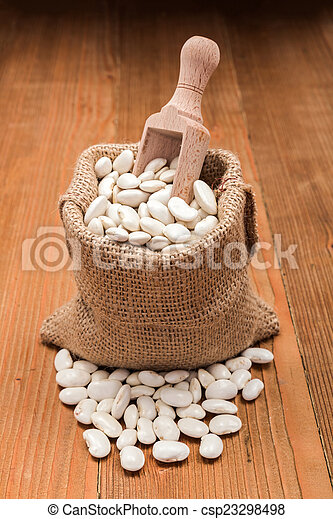 Haricot beans in burlap bag - csp23298498