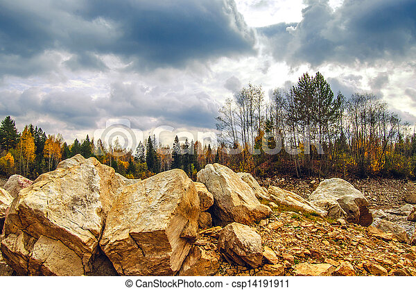 harsh landscape with rocks in the foreground - csp14191911