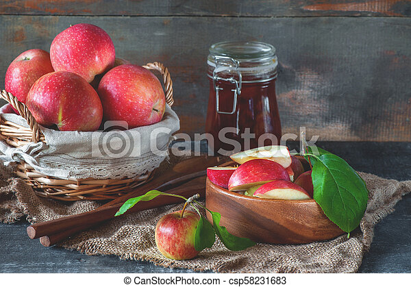Harvest of apples in the basket prepared for cooking in the fall on the table. Village. The horizontal frame - csp58231683
