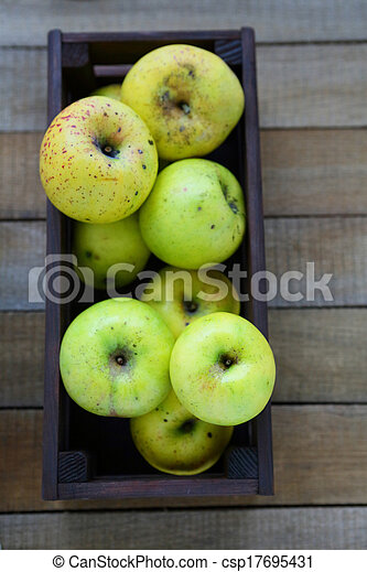 harvest of green apples in wooden crate - csp17695431