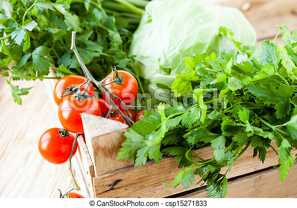 Harvest vegetables in a wooden box - csp15271833