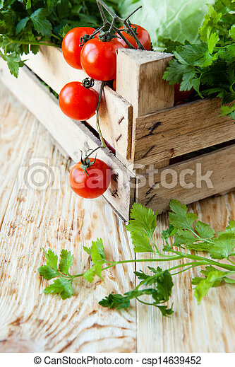 Harvest vegetables in a wooden crate - csp14639452