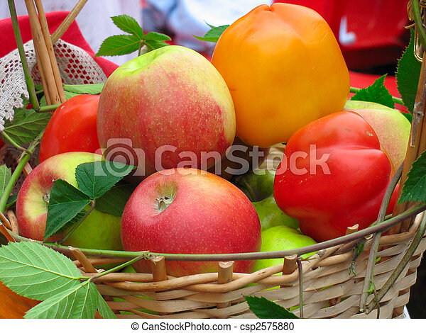 Harvesting apples, leaves and sweet peppers in wooden basket - csp2575880