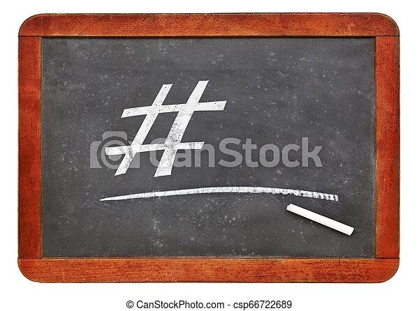 hashtag and white chalk on blackboard - csp66722689