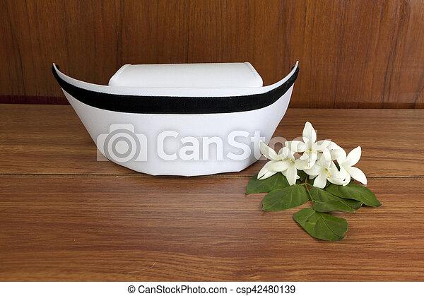 Hat Nurse White And Millingtonia Hortensis Flowers On Wood Table